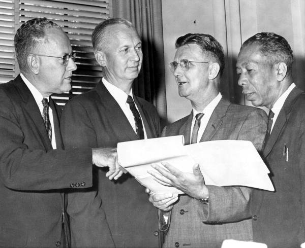 University Presidents at Board of Control meeting discussing impact of higher admission standards and expanding junior colleges. From left are: Presidents Dr. Gordon W. Blackwell, Florida State University; Dr. John Allen, University of South Florida; Dr. J. Wayne Reitz, University of Florida, and Dr. George W. Gore, Jr Courtesy State Archives of Florida